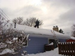 Home Inspector on Snow Covered Roof