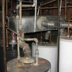 Worst Common Vent Ever – How can you get four water heaters to backdraft at the same time?  Just do something like this.