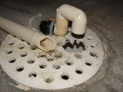Water softener discharge at floor drain
