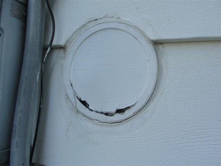 Coffee can lid for siding