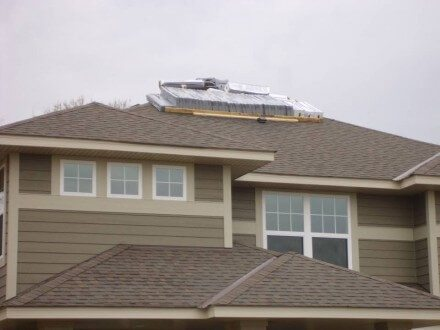 Shingles Delivered on top of brand new