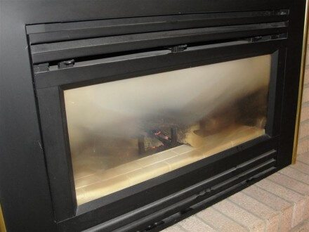 Dirty glass at gas fireplace