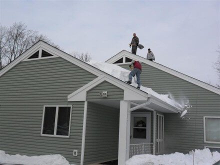 Shoveling snow off roof