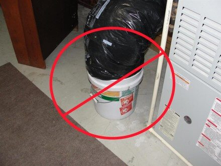 Restrictive combustion air bucket