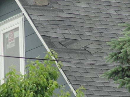 Damaged shingles close-up