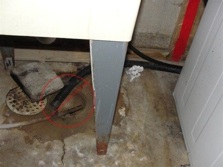 Sump pump discharge into floor drain