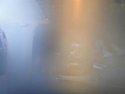 Backdrafting water heater with lens fogged