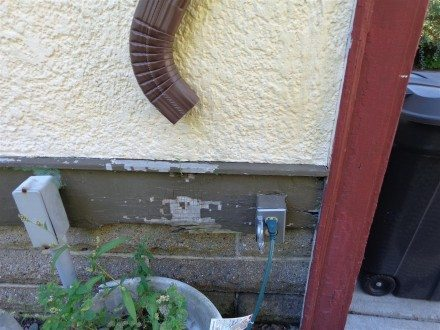 Downspout aimed at outlet