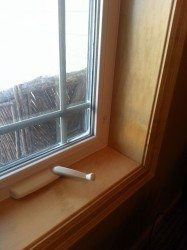 Vinyl window with maple trim