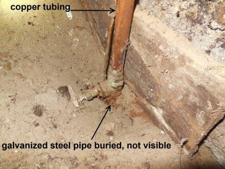 Galvanized supply pipe buried