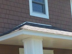 Aluminum flashing from roof line to Hardie shake