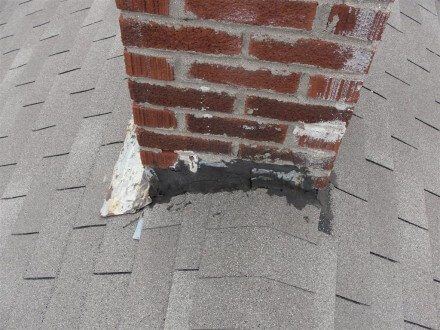 Tar patching at chimney flashing