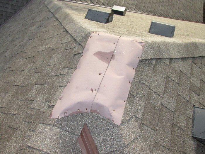 Roof - bad flashing at peak of roof