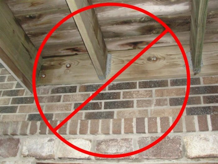 No deck attachment through brick veneer