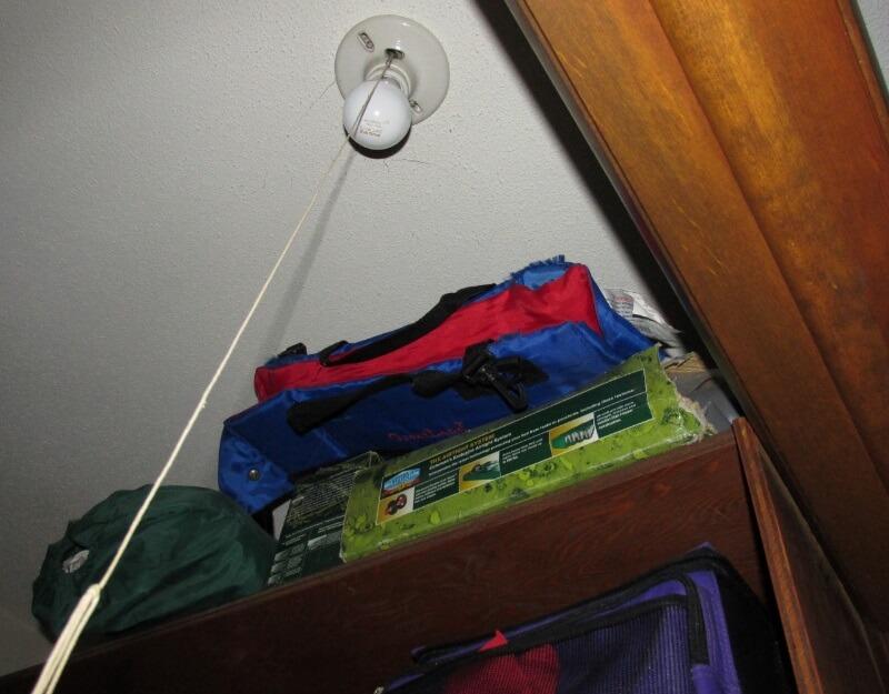 exposed light bulb in closet