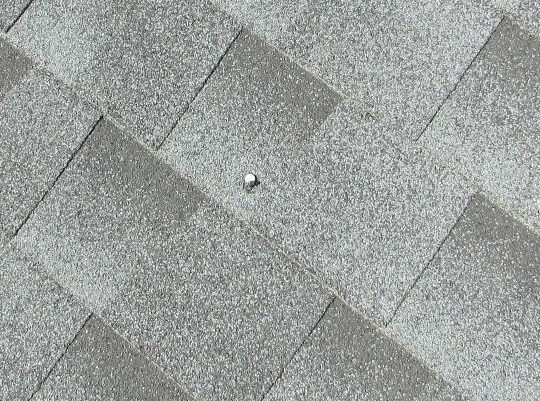Roofing - nail punched through shingle