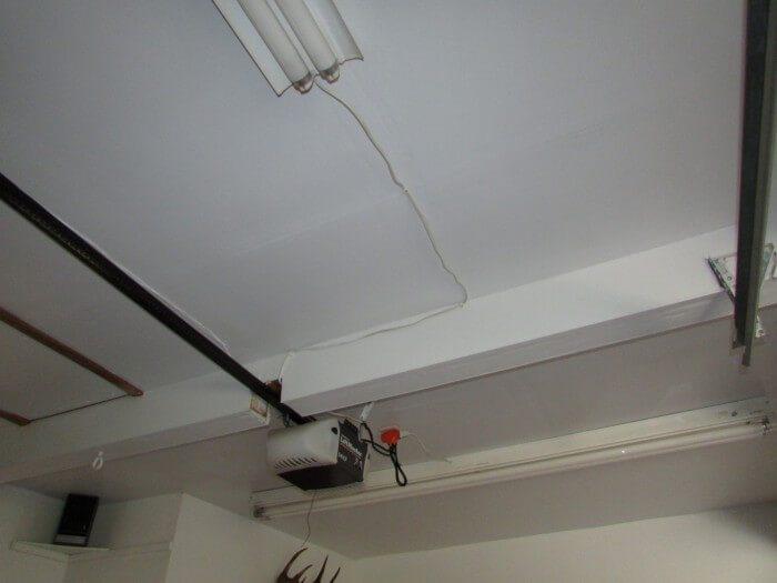 Cut beam for garage door opener track